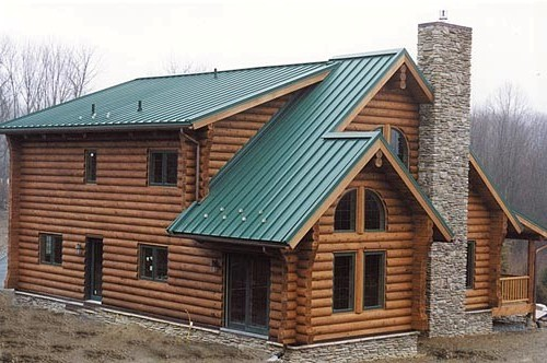Log homes sport metal roofs for Tin roof house designs